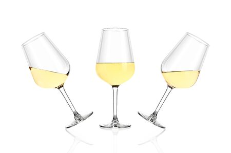 Three glasses of white wine isolated on white background. The glasses are tilted in different directions. Archivio Fotografico - 136036281