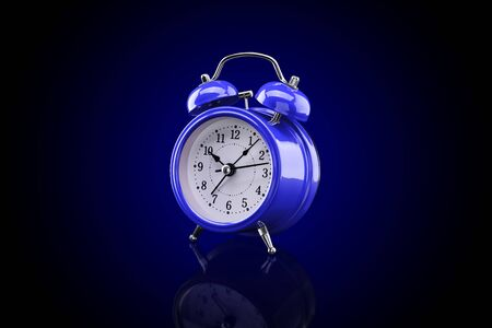 Blue alarm clock with reflection on glass close-up isolated on dark background with blue gradient. Archivio Fotografico - 137446680