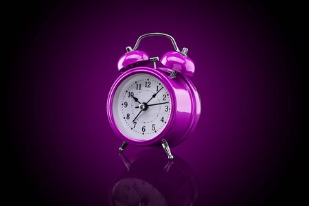 Purple alarm clock with reflection on glass close-up isolated on dark background with purple gradient. Archivio Fotografico - 137446672