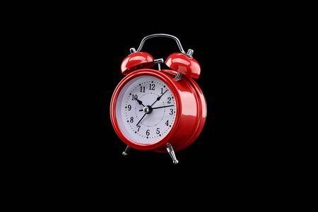 Red alarm clock close-up isolated on dark background. Archivio Fotografico - 137446780