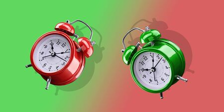 Red and green alarm clocks on a gradient background of red and green. Archivio Fotografico - 137447431