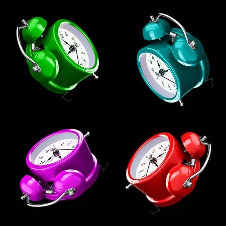 Four color alarm clocks isolated on a dark background. Archivio Fotografico - 137447353