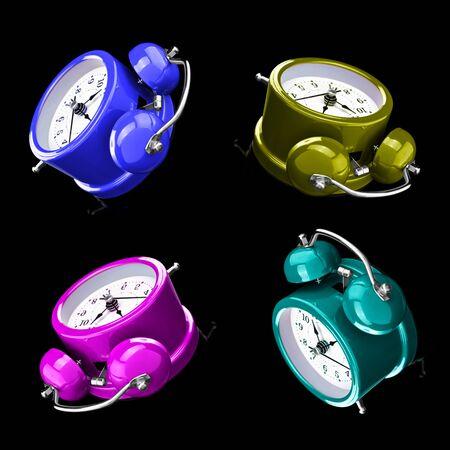 Four color alarm clocks isolated on a dark background. Archivio Fotografico - 137447903