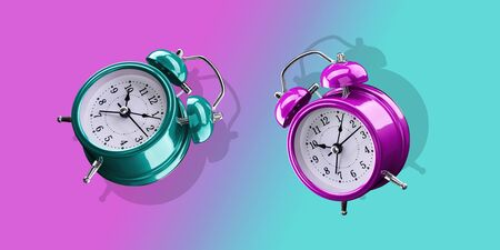 Alarm clocks in purple and turquoise on a gradient background of purple and turquoise. Archivio Fotografico - 137447982