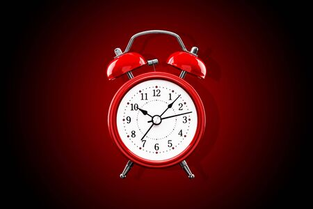 Red alarm clock close-up isolated on dark background with red gradient. Archivio Fotografico - 137447668