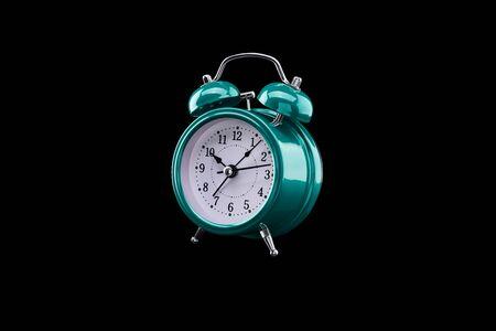 Turquoise alarm clock close-up isolated on dark background. Archivio Fotografico - 137448346