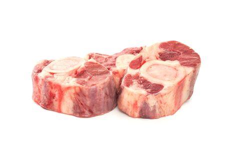 Three slices of fresh shank steak on a white background. Fresh Osso Buco steaks.