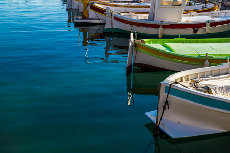 owing: Mediterranean style owing boats in a glassy harbour