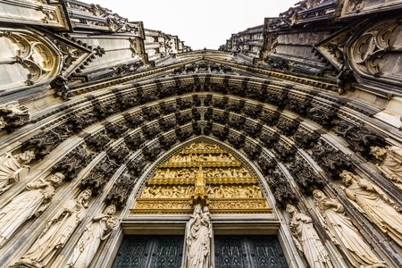 straight up: The main archway to the entrance to Cologne cathedral taken looking straight up with Mary at the center.