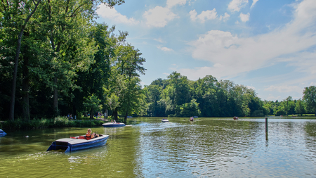 Tourists have fun with boats on a artifial lake in Germany Editöryel