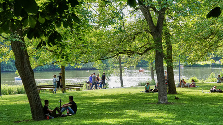 Ludwigsburg, Germany - June 10th, 2017: People having a Picnic in Castle park Monrepos during the annual fish festival.