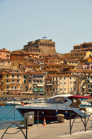 the port of Porto Santo Stefano with his Fortress Stok Fotoğraf