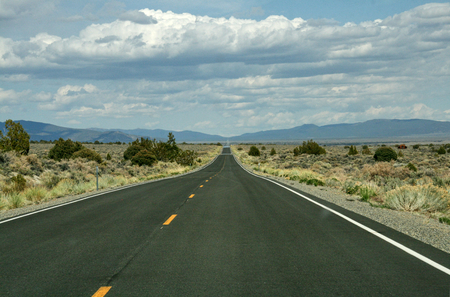 A very long long straight road throug american desert Stok Fotoğraf