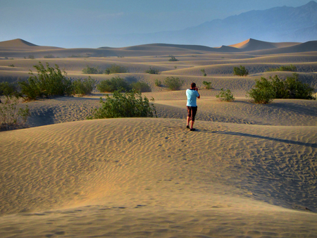 A man take a Photo on the Death Valley desert