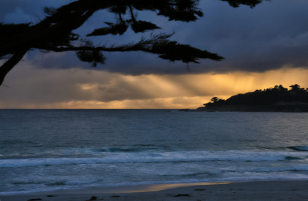 Sunset after a storm in a beach bei big Sur, West coast of California