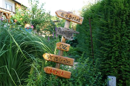 Signs with the names of fantasy forests, - Camelot, nowhere land, oz, Sherwood, Narnia, Middle-earth