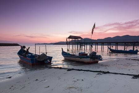 Amazing seascape sunrise with boat in George Town, Penang, Malaysia Stock Photo