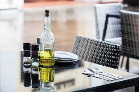 peppercorn: Olive oil, salt and pepper on a table for dining