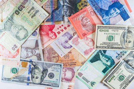 currencies: Multiple Currencies banknotes as colorful background showed the global money financial business economy crisis Stock Photo