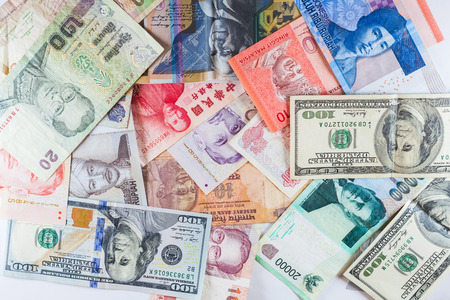 Multiple Currencies banknotes as colorful background showed the global money financial business economy crisis Stock Photo