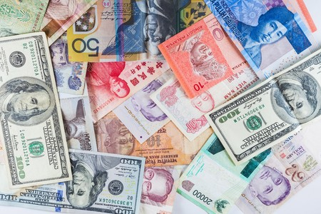 economy crisis: Multiple Currencies banknotes as colorful background showed the global money financial business economy crisis Stock Photo