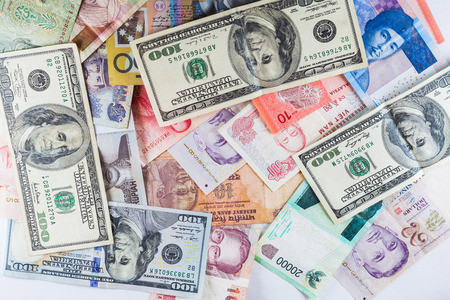 global currencies: Multiple Currencies banknotes as colorful background showed the global money financial business economy crisis Stock Photo