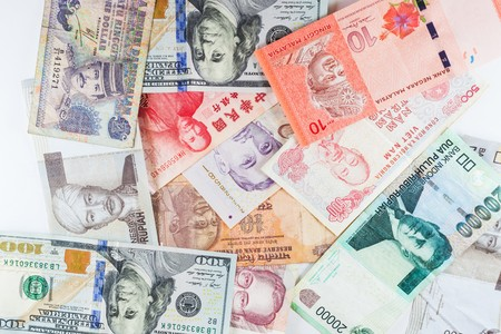 showed: Multiple Currencies banknotes as colorful background showed the global money financial business economy crisis Stock Photo
