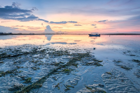 kuta: Holiday in Bali, Indonesia - Reflection Sunrise in Tanjong Benoa with boat Stock Photo