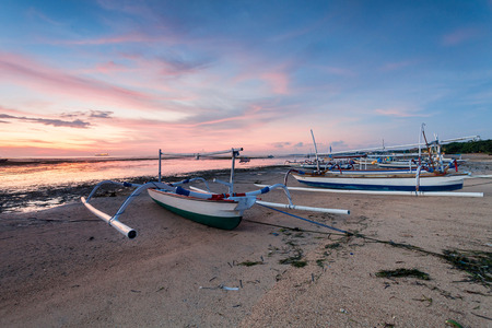 Holiday in Bali, Indonesia - Reflection Sunrise in Tanjong Benoa with boat Stock Photo