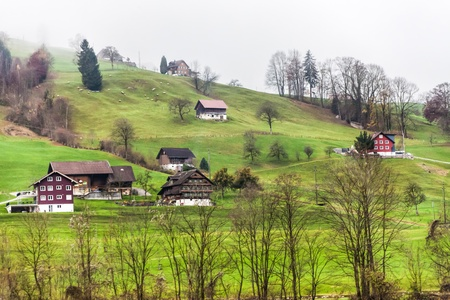 towards: Holiday in Switzerland - Beautiful foggy view of winter landscape towards Engelberg, Switzerland