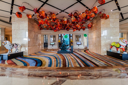 lavish: Taipa, Macau - February 2, 2015: The MGM Hotel, Macau. This lavish, high-rise resort with a grand, interior plaza, lies next to Nam Van Lake