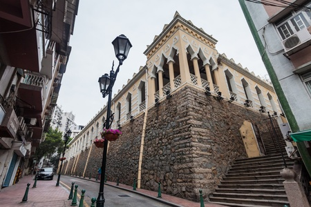 appointed: Senado, Macau - February 3, 2015: Moorish Barracks was originally the barracks of Indian soldiers appointed from Goa to Macau.The brick and stone neo-classical structure with Mughal influences standing on a raised granite platform above the street.