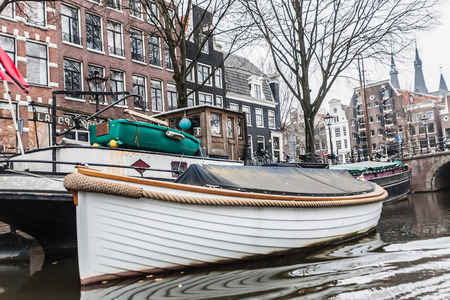 Amsterdam Holland, 4 December 2014 : Canal Cruises view of Amsterdam. Amsterdam is the Netherlands' capital, known for its artistic heritage, elaborate canal system and narrow houses with gabled facades, legacies of the city's 17th-century Golden Age. Editorial