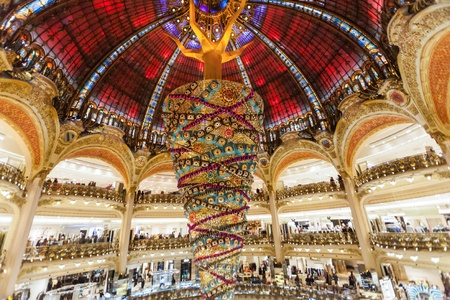 reverse: Paris France, November 2014: Holiday in France - Lafayette Galeries during winter Christmas