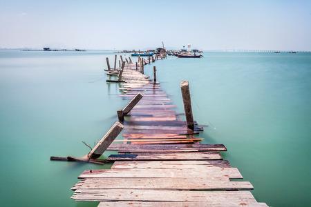 overflow: Water overflow on a broken wooden bridge