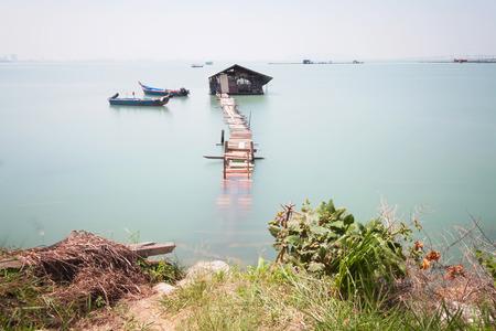 Water overflow on a broken wooden bridge