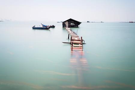 walk path: Water overflow on a broken wooden bridge