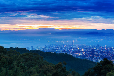 george: Metropolitan cityscape view from top of the hill or mountain during sunrise sunset