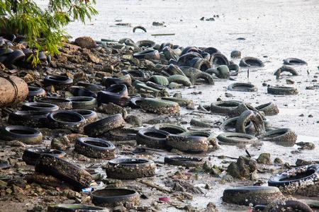 muddy: Dirty muddy beach showing a dump site