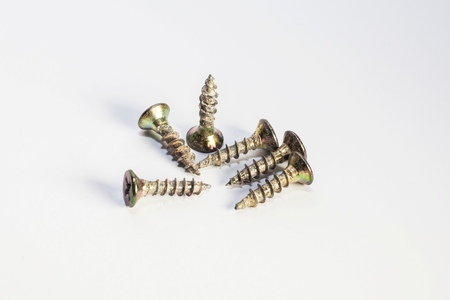 Used old screws with isolated white background for commercial Stock Photo