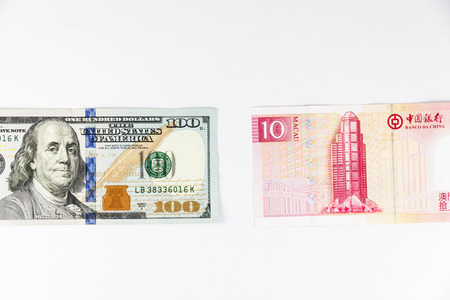global rates: Close up view of US Dollar and Macau China Pataca indicating strong currency exchange rate Stock Photo