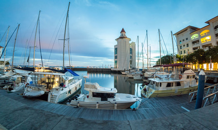 Straits Quay Lighthouse view during sunrise with yachts and boats as foreground Stock Photo