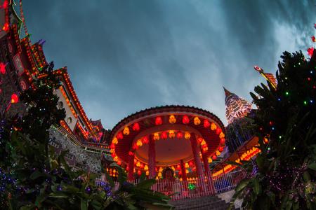 si: Kek Lok Si Temple light up with firework show Stock Photo