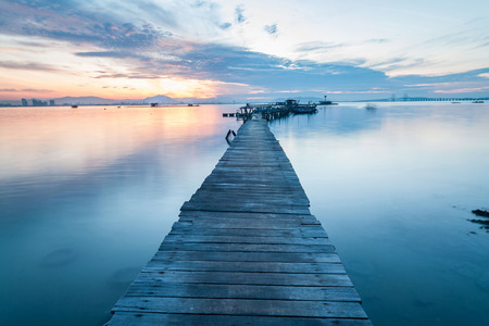 Real wooden bridge view of sunrise background