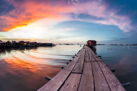Wooden bridge Clan Tan Jetty view during sunrise in George Town, Penang