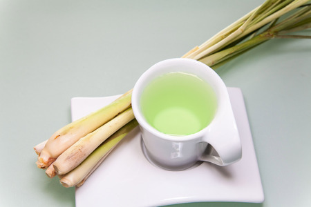 Lemon grass drink with a white cup view in close up with blur isolated background