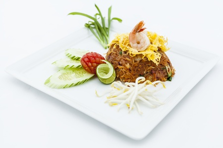 Fried noodle thai style with tamarin and chilies sauce .(Pad thai) photo