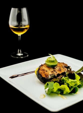 Salmon steak with garlic and pepper sauce. photo