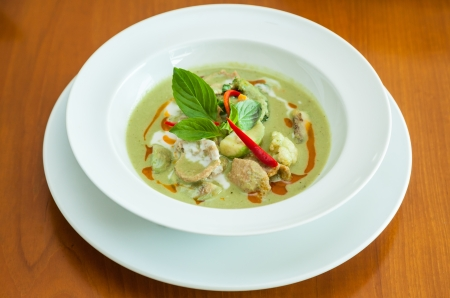 Chicken green curry with eggplant . ( Authentic thai food ) photo