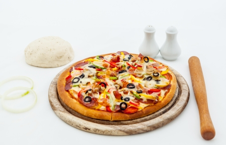 Delicious homemade pizza with ham and vegetables. photo